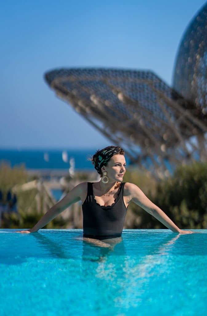 Hotel Arts Barcelona Elo in the pool in swimsuit