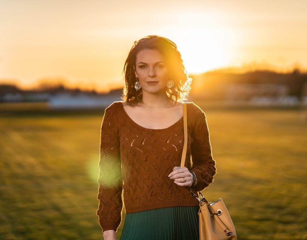 Elo wearing sezane brown jumper in sunset