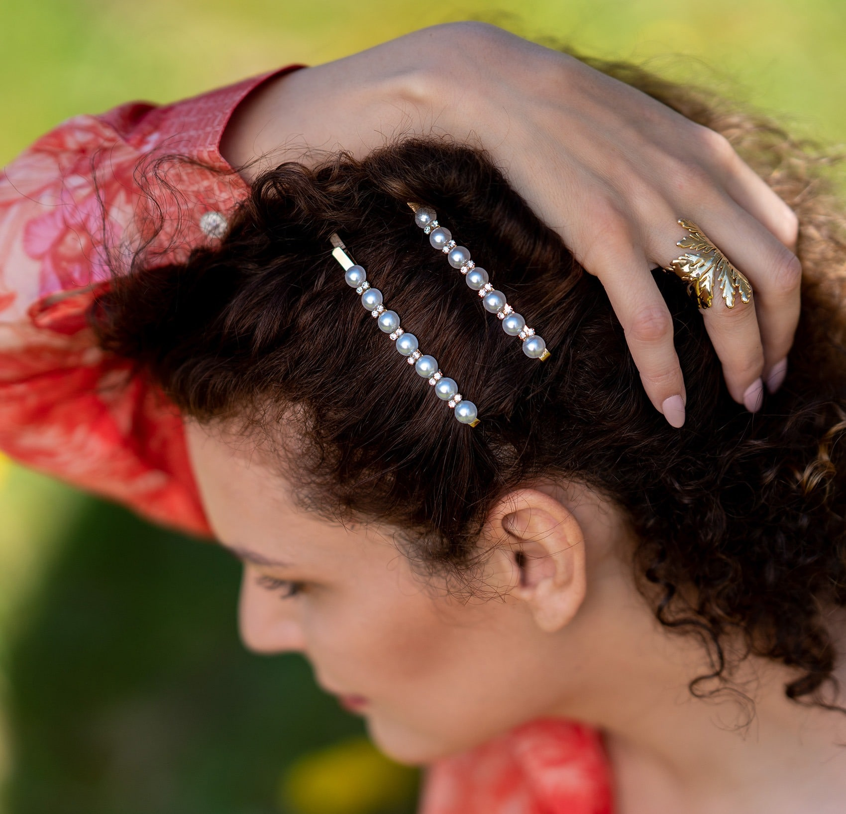 Curly hair and gold hair clip