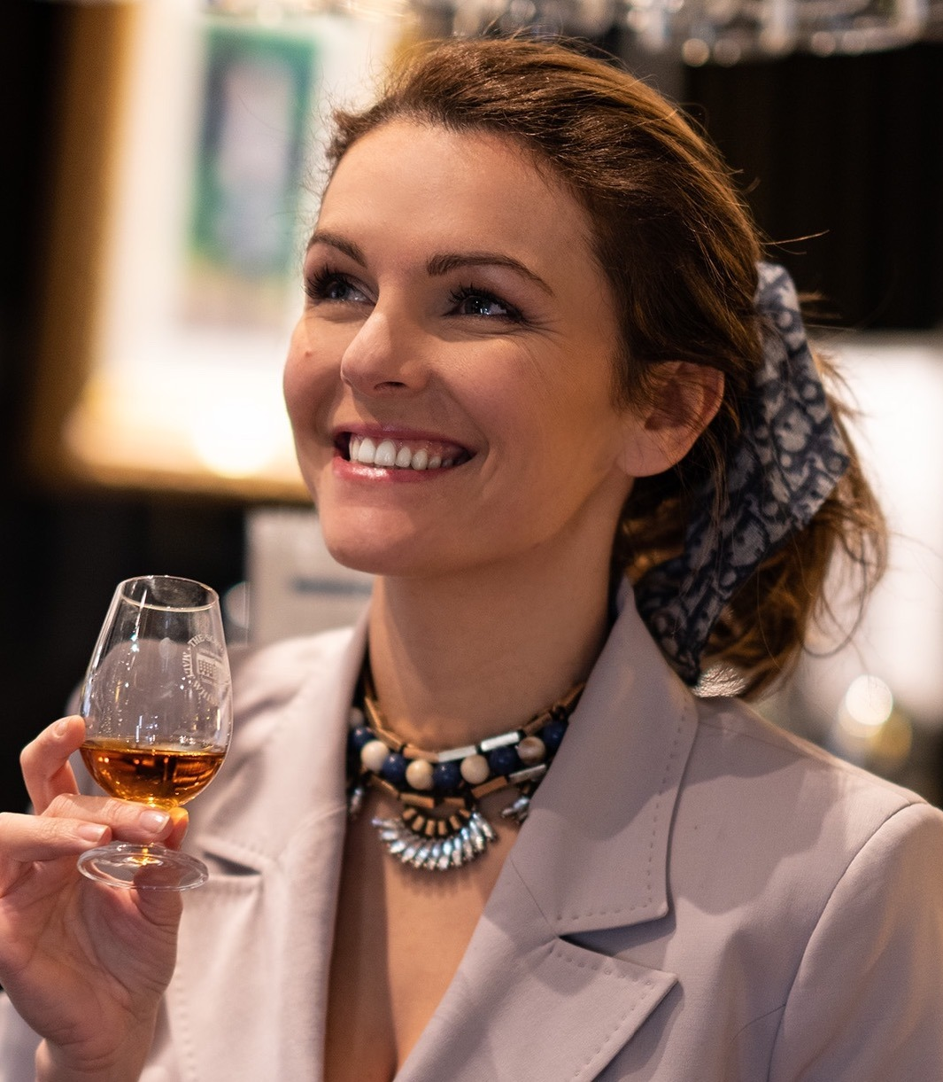 Drinking whisky in a Celine blazet and Dior scarf