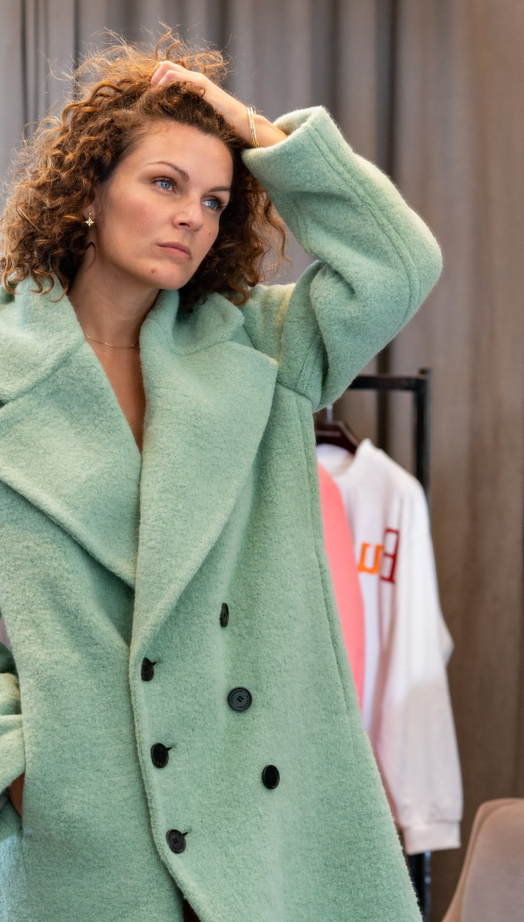 Green wool coat in Burberry's VIP fitting room