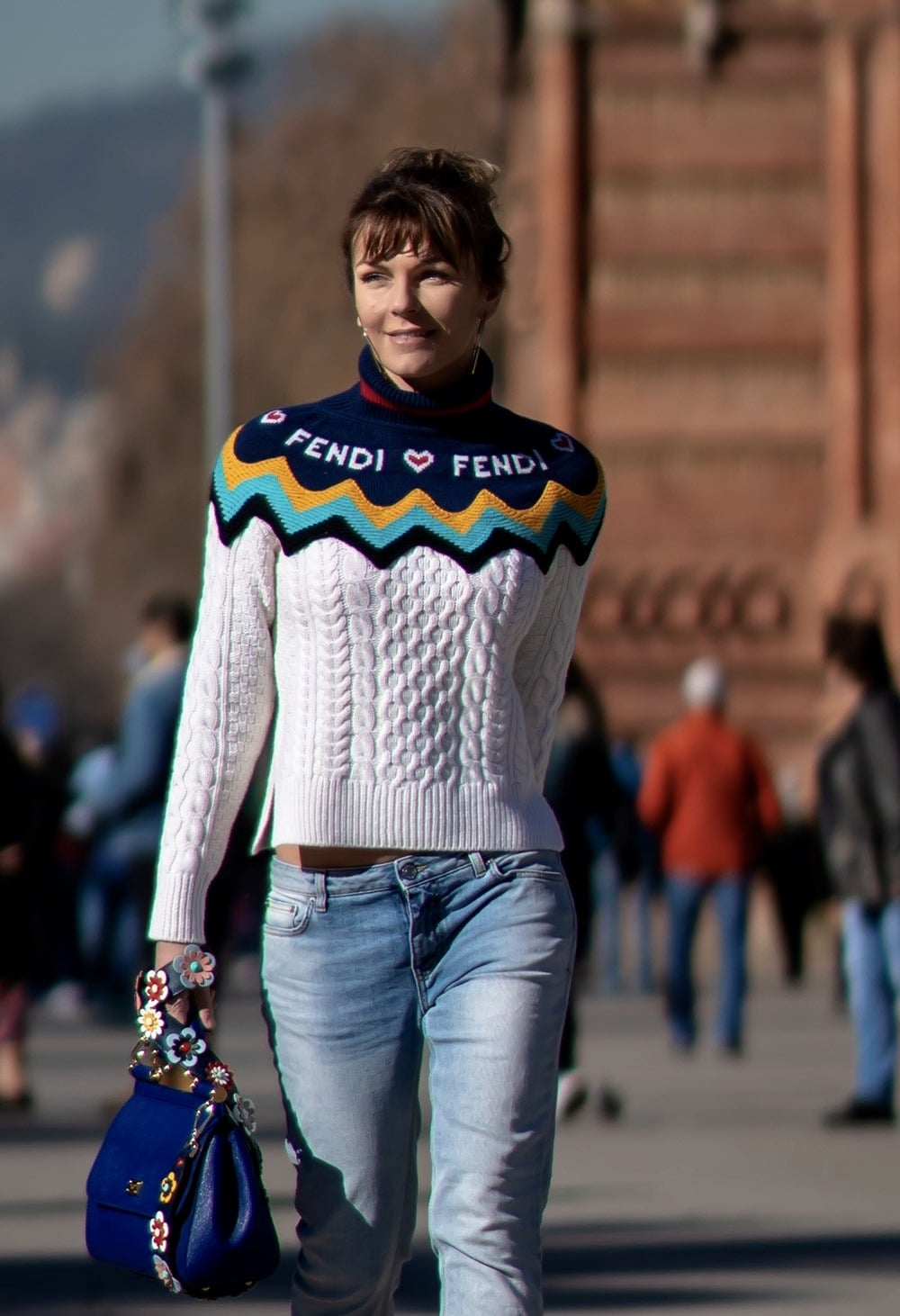 Walking in the street in Fendi jumper and denim