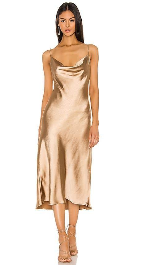 Model in gold slip dress