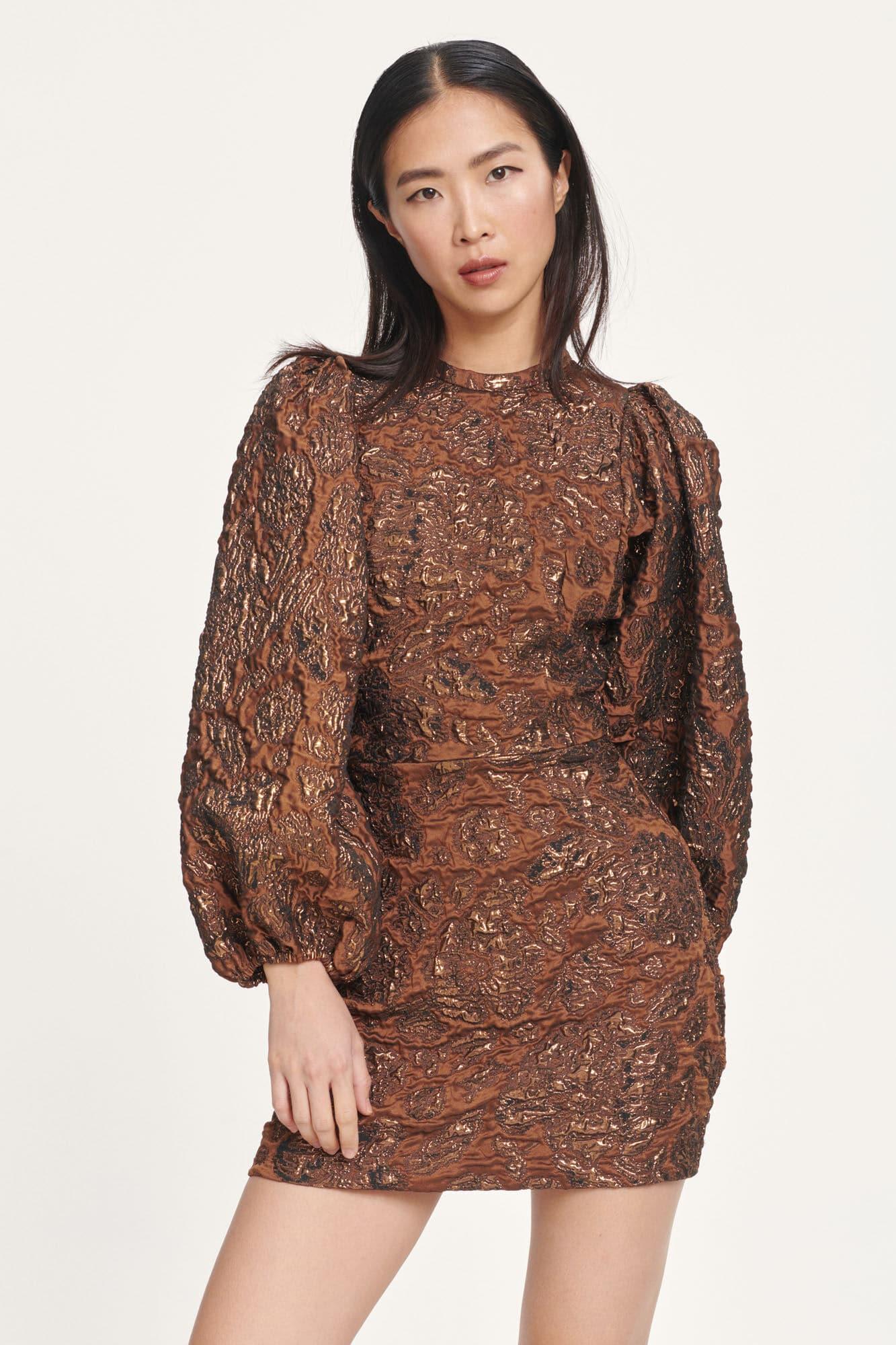 Model in brown mini dress