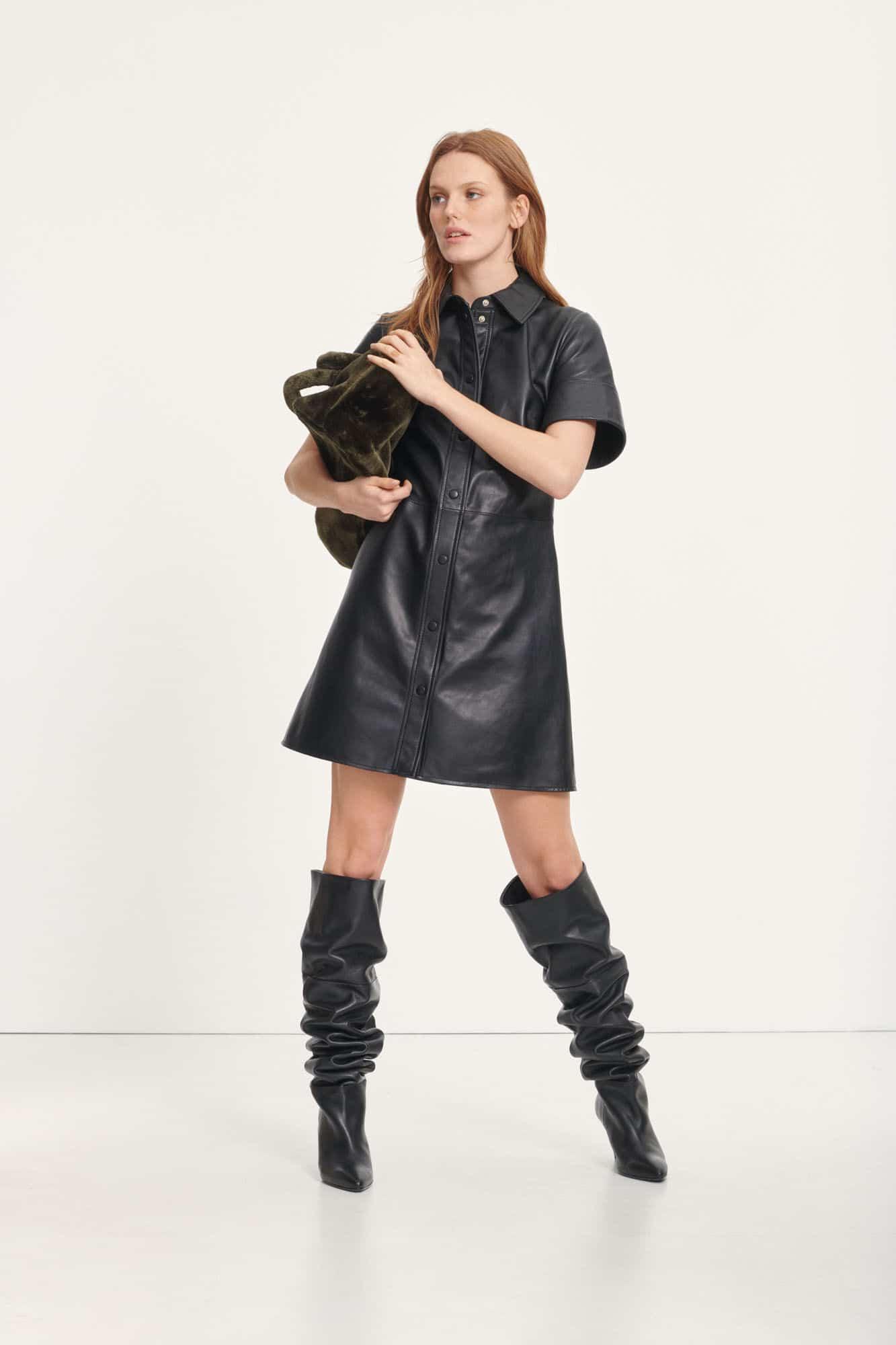 Model in black leather dress