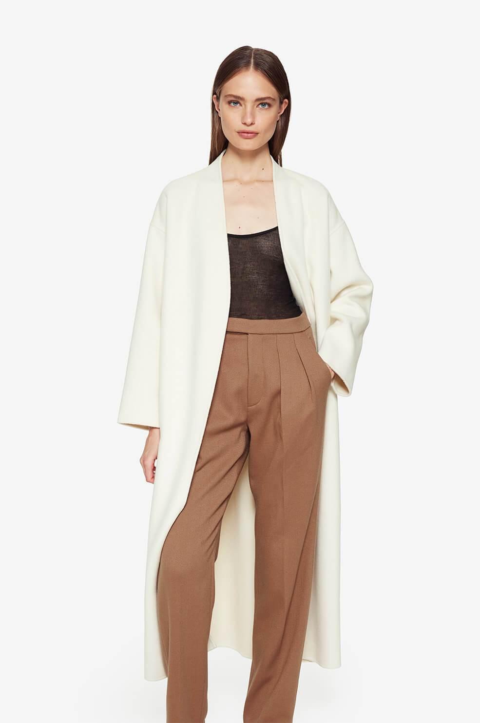 Woman in long white coat