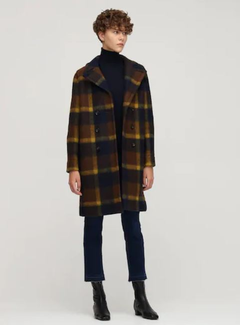 Girl in a plaid coat