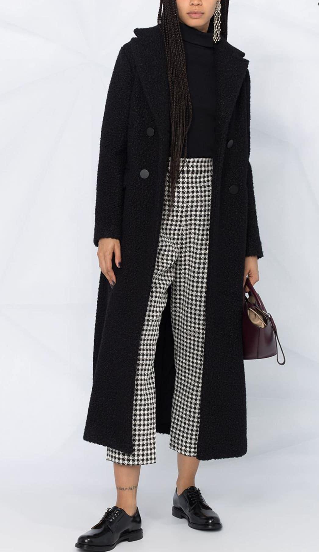 Girl in long black coat