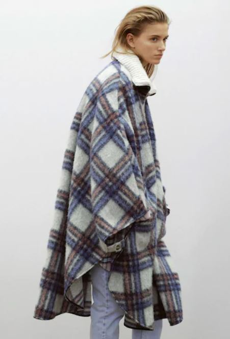Woman in a plaid cape