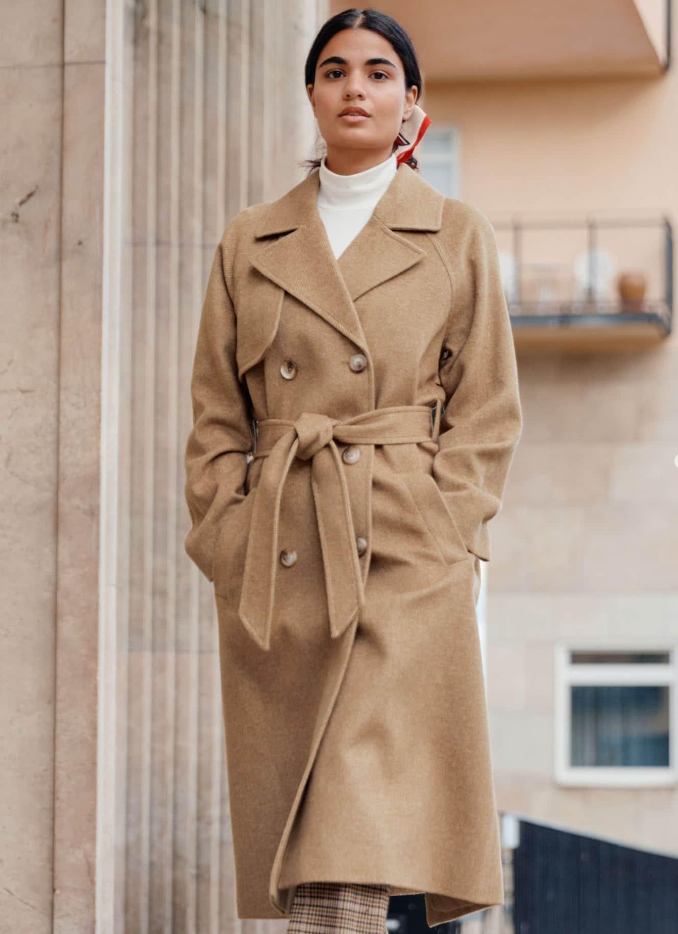 Woman in wool beige trench coat