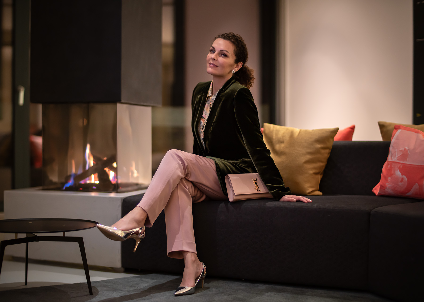 woman on a sofa by a fireplace