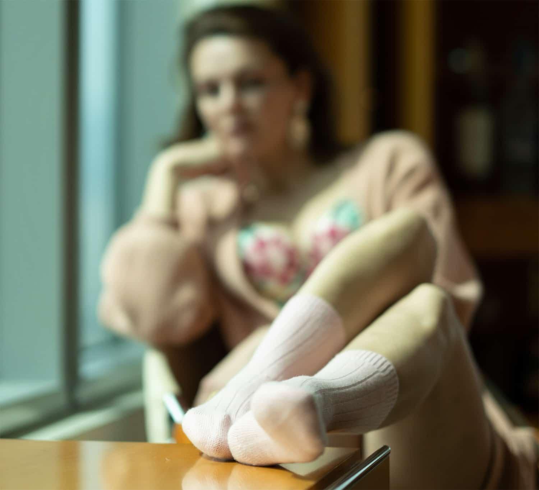 woman with socks in window