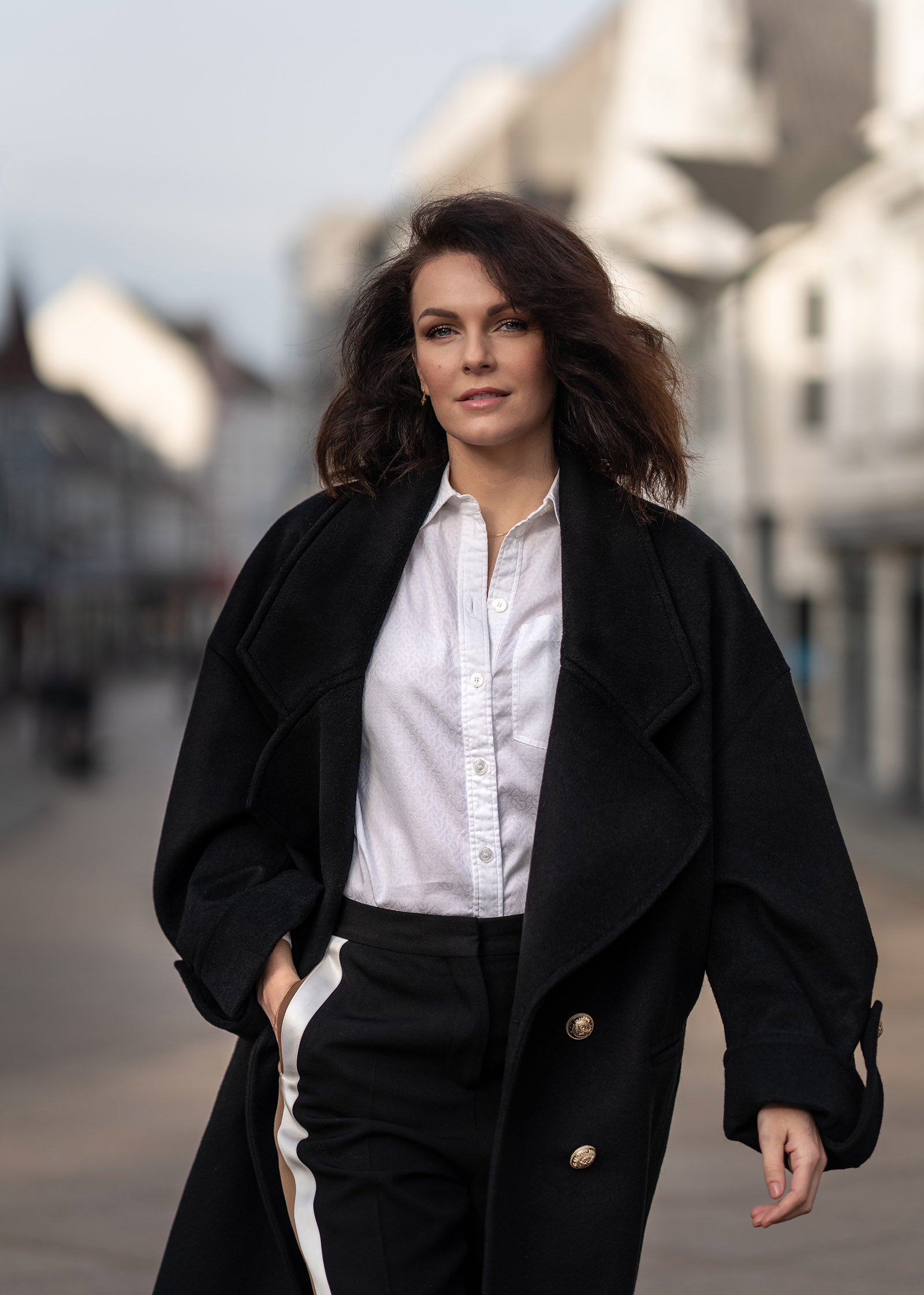 woman in black coat and white burberry shirt