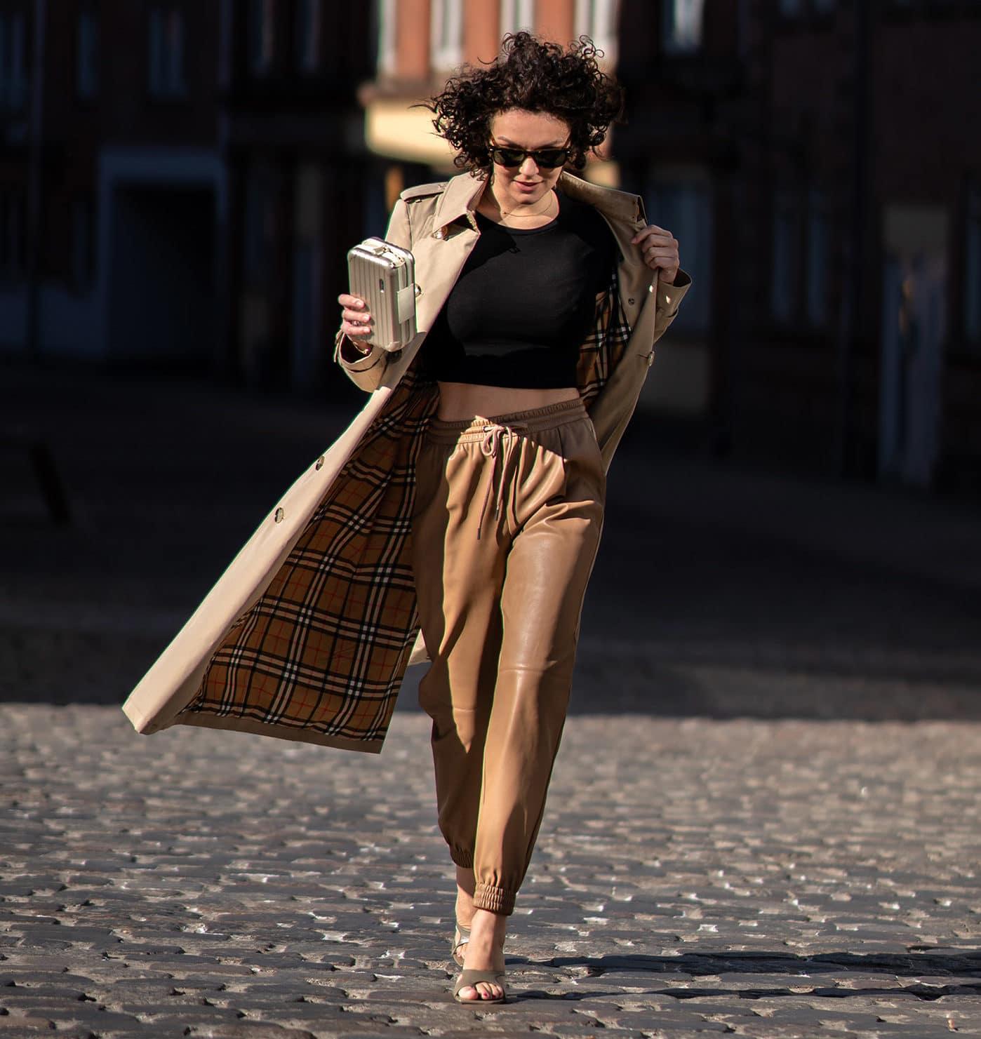 Girl walking in burberry trench coat