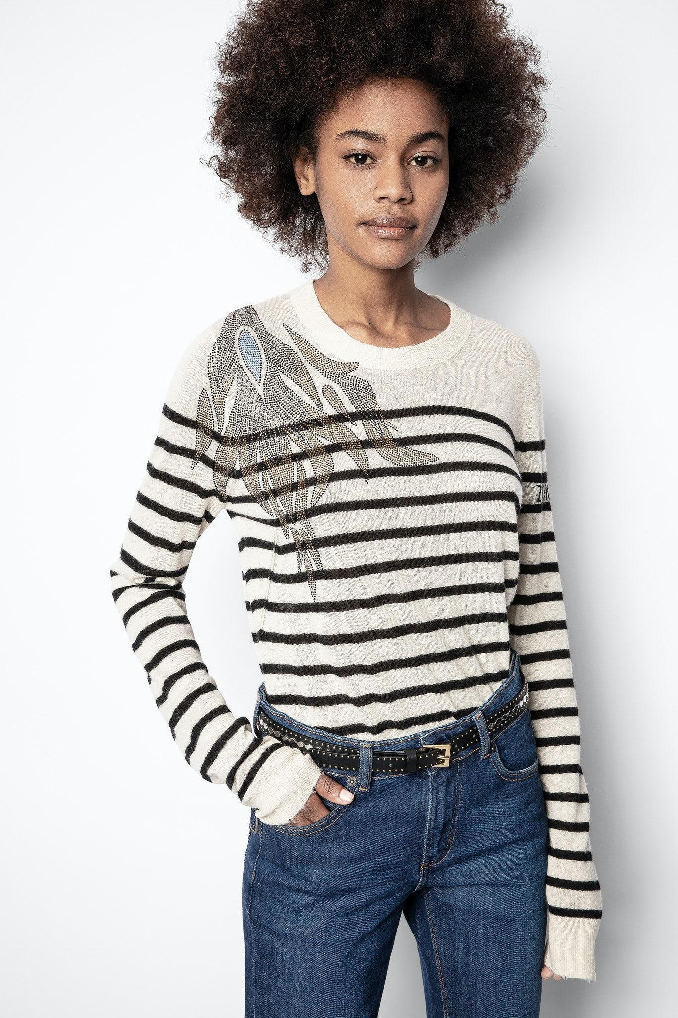 Girl in striped jumper