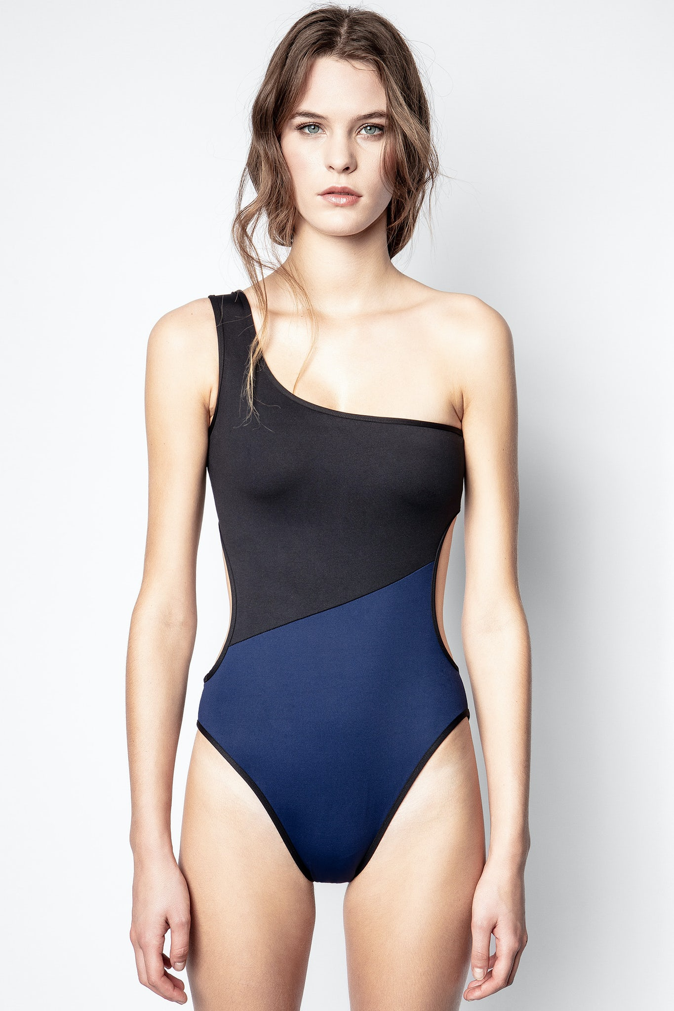 Girl in asymetrical swimsuit