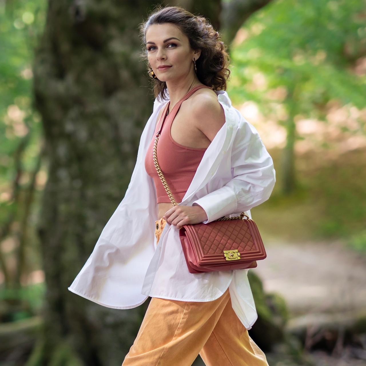 Girl walking with Chanel bag