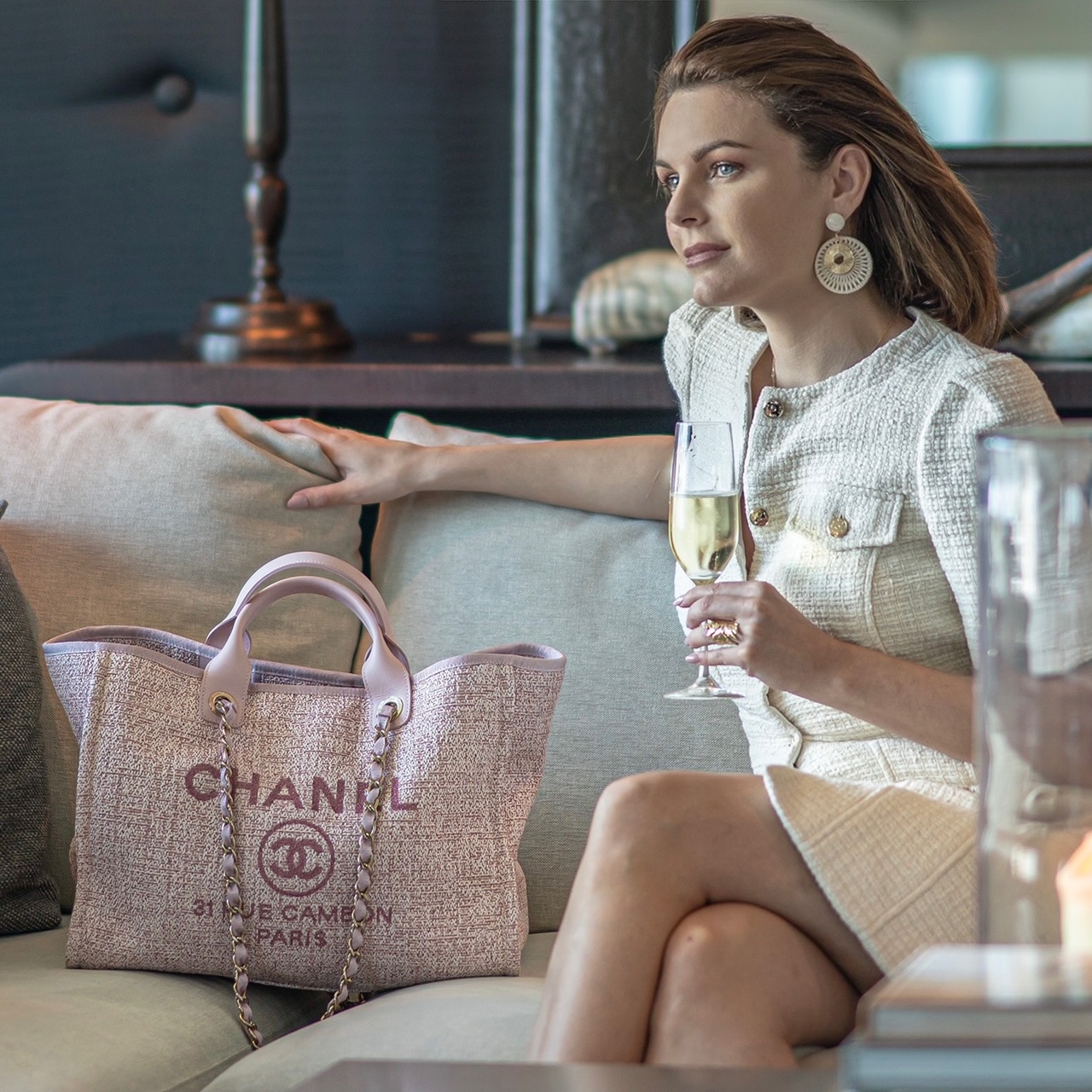 Girl drinking champagne with Chanel bag