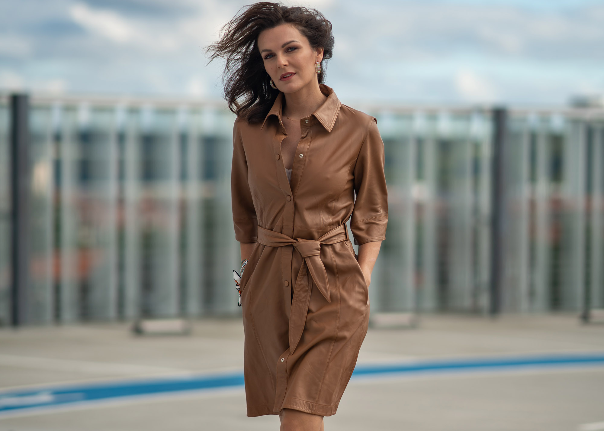 woman in brown leather dress