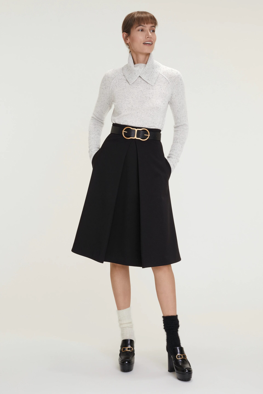 Girl in midi pleated skirt