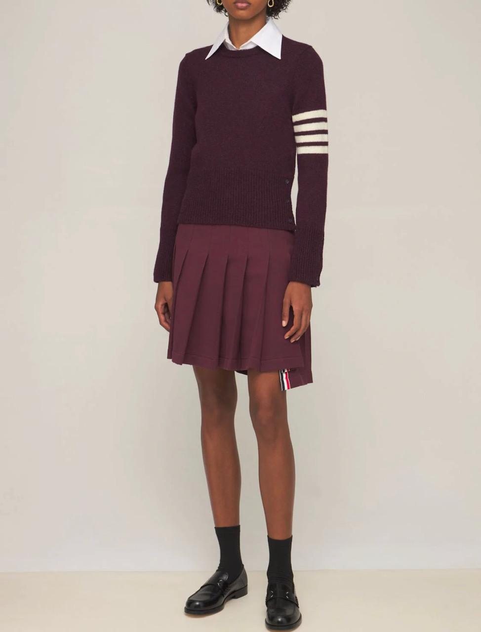 Girl in pleated skirt